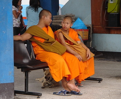 Young Thai monks waiting for their bus