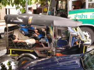 Tuk Tuk Drivers Sleeping in their Vehicle
