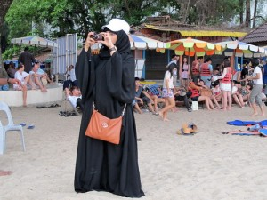 Muslim woman on the beach in Penang, Malaysia