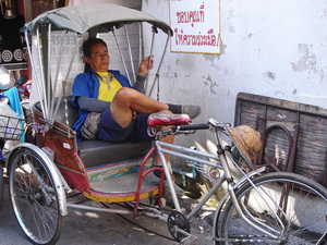 napping on a rickshaw in Chiang Mai Thailand
