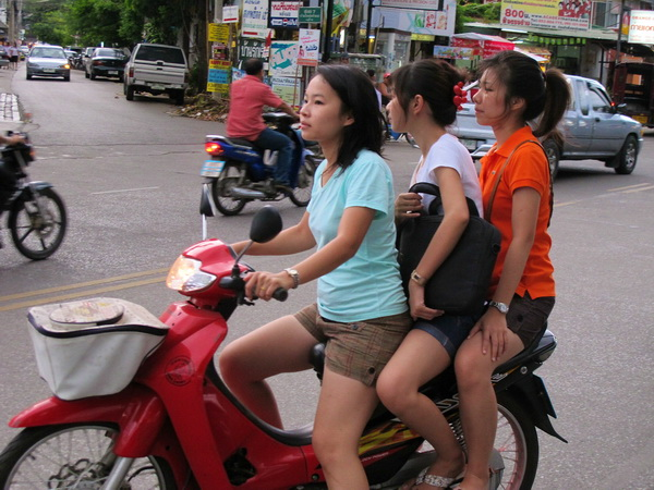 3 riders on scooter