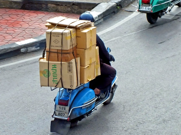 overloaded scooter in Thailand