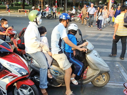 4 riders on motorbike in Vietnam