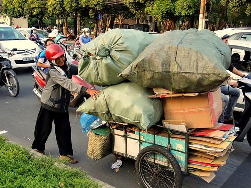 man pushing big cart