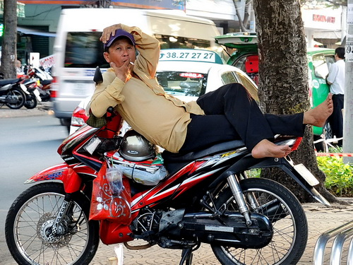 man relaxing on bike