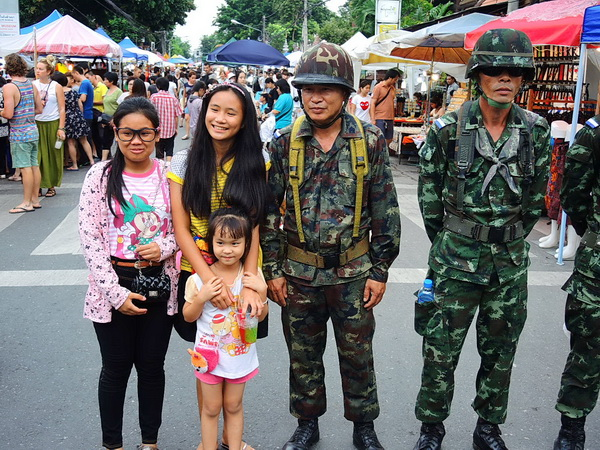 tourists posing with soldiers